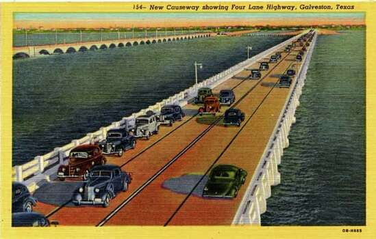 UNITED STATES - CIRCA 1940:  Postcard view of the causeway over Galveston Bay to Galveston, Texas shows vintage automobiles driving along the four lane highway.  (Photo by Lake County Museum/Getty Images) Photo: Curt Teich Postcard Archives, Getty Images / Curt Teich Postcard Archives