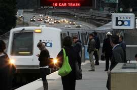 BART trains and traffic flow as usual at the Rockridge station in Oakland, Calif., Monday, Aug. 5, 2013, after a late-night decision by Gov. Jerry Brown to stop the BART strike.   Brown imposed a seven-day injunction and created a three-member panel to investigate the contract talks. (AP Photo/The Contra Costa Times,Laura A. Oda )