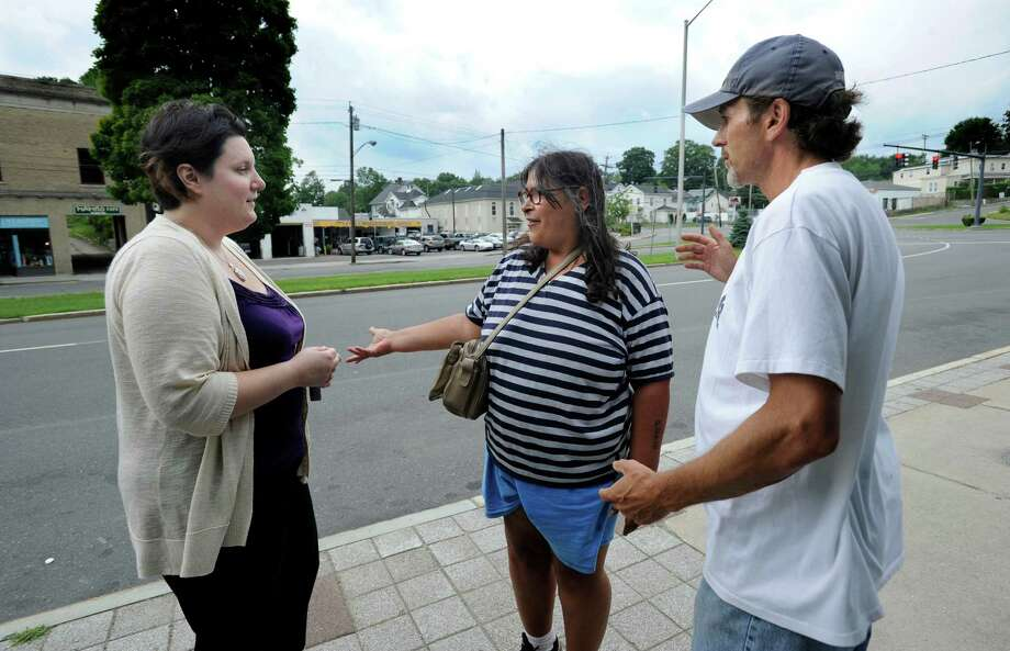 Michele Conderino, 34, of Bethel, left, Director of Homeless Services at Catholic Charities of Fairfield County, talks with Teresa and Ron Mace on Kennedy Avenue in Danbury, Conn., Thursday, August 1, 2013. Photo: Carol Kaliff / The News-Times