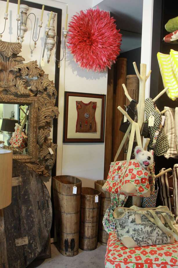 """PELUCHE DÉCOROpened earlier this year by TBS's """"Movie and a Makeover"""" vet Deanna Breaux Gathe, Peluche Decor stocks stylish examples of furniture, art and accessories from around the globe interspersed with picture frames, trays, throw pillows and other house candy (plus jewelry and baby goods) all packed into the Uptown Park space. The Turkish hammered gold jewelry, feathered juju hats from Cameroon and pool-friendly melamine wine glasses are must-haves. 1111-12 Uptown Park, 713-552-1100, peluchedecor.com. Photo: Gary Fountain, Freelance / Copyright 2013 Gary Fountain"""
