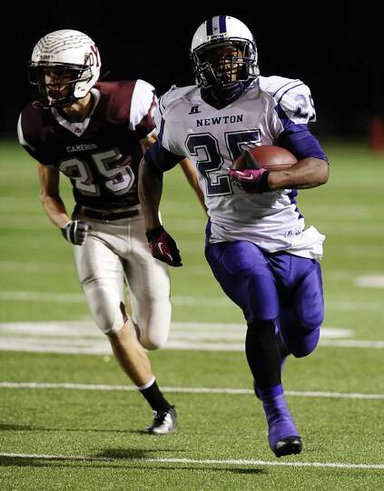 Newton running back Brandon Johnson, #25, charges down the field for the first Eagles touchdown duri