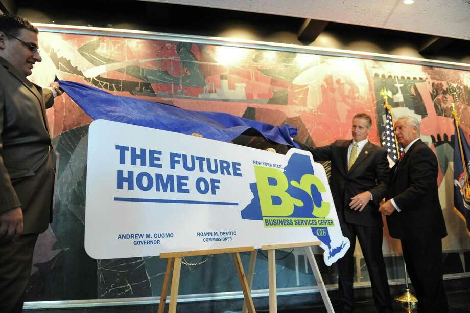 Joseph Rabito, left, executive deputy commissioner OGS, Lt. Governor Robert Duffy and Mayor Jerry Jennings unveil plans for a $47 million rehab of Building 5 at the Harriman State Office Campus on Thursday Aug. 15, 2013 in Albany, N.Y. (Michael P. Farrell/Times Union) Photo: Michael P. Farrell / 00023530A