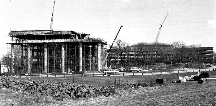 Construction of the 442,455-square-foot building that Pitney Bowes has called home for nearly three decades, shown here in 1984, was a precursor of a commercial and office construction boom in StamfordâÄôs south end. The complex on Elmcroft Road in Stamford, Conn. allowed the company to consolidate staff from Stamford and New Canaan. It at one time housed more than 1,000 workers, but now about 550 are employed there. Photo: File Photo