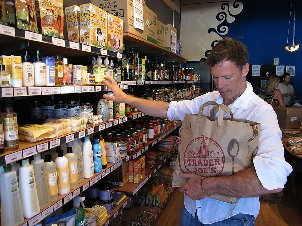 Mike Hallatt stocks shelves with Trader Joe's products at his Pirate Joe's market in Vancouver, B.C. on Friday, July 26, 2013. Hallatt opened the shop, which resells Trader Joe's products, in 2012 and is now being sued by California-based Trader Joe's. Hallatt makes frequent trips to the United States to stock up on product during shopping sprees at Trader Joe's despite having his photo posted at most locations in Washington state.