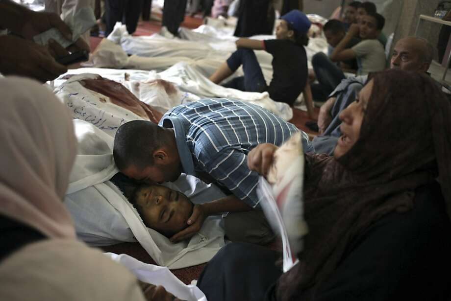 Egyptians mourn over the bodies of their relatives in the El-Iman mosque in Nasr City, Cairo. Egypt faces a phase of uncertainty after the bloodiest day since its Arab Spring began. Photo: Khalil Hamra, Associated Press