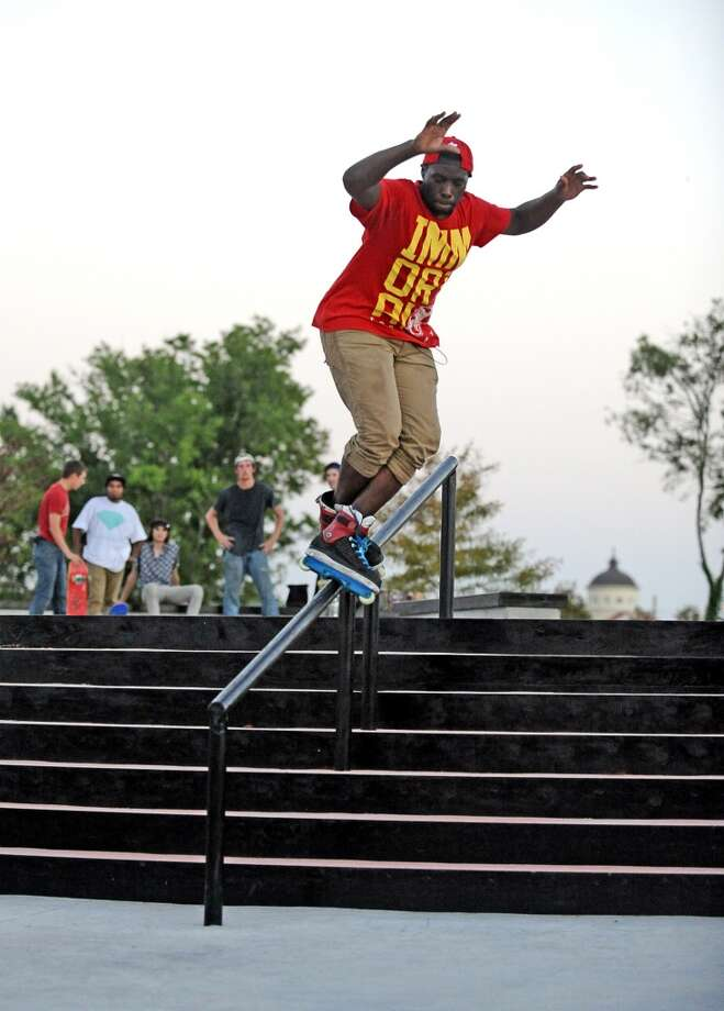 Dwight Daly, 19, hits the handrail at the Beautiful Mountain Skate Plaza on Tuesday, August 6, 2013. Photo taken: Randy Edwards/The Enterprise Photo: Beaumont Enterprise