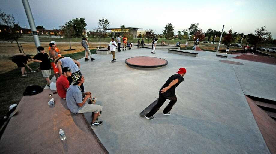 Locals and visitors enjoy the first official day at the Beautiful Mountain Skate Plaza on Tuesday, August 6, 2013. Photo taken: Randy Edwards/The Enterprise Photo: Beaumont Enterprise