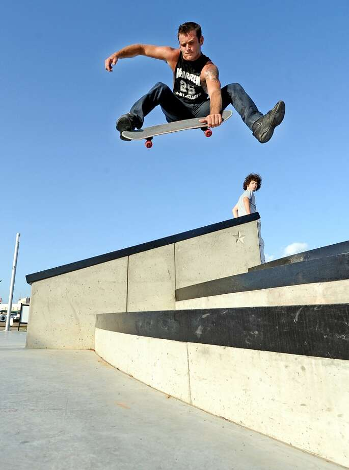 Justin Tidwell of Wildwood attempts a Benihana on his skateboard at the Beautiful Mountain Skate Plaza on Tuesday, August 6, 2013. Photo taken: Randy Edwards/The Enterprise Photo: Beaumont Enterprise