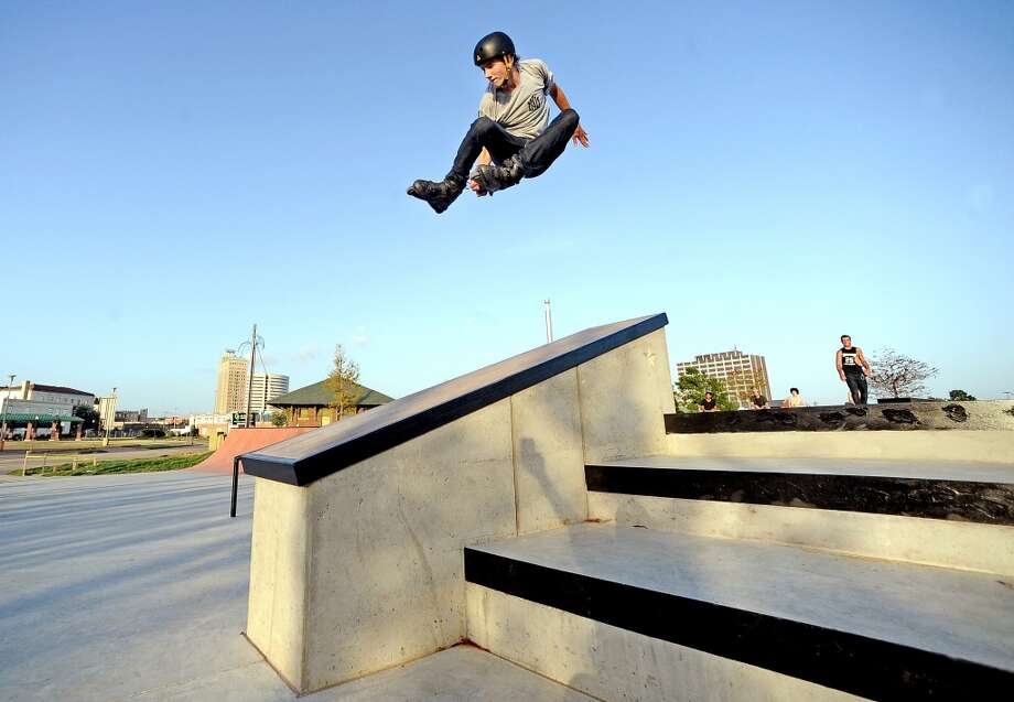 Zach Pavel, 17, launches over the star ledge with a huge stale grabbed 180 at the Beautiful Mountain Skate Plaza on Tuesday, August 6, 2013. Photo taken: Randy Edwards/The Enterprise Photo: Beaumont Enterprise