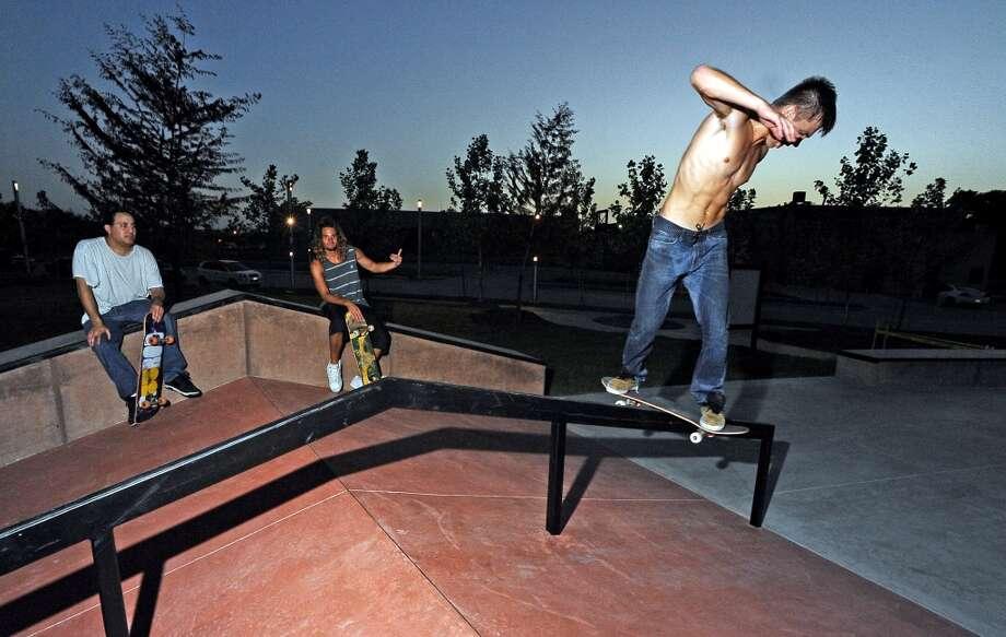 Miles Watson, 19, hits the A-frame rail at the Beautiful Mountain Skate Plaza on Tuesday, August 6, 2013. Photo taken: Randy Edwards/The Enterprise Photo: Beaumont Enterprise