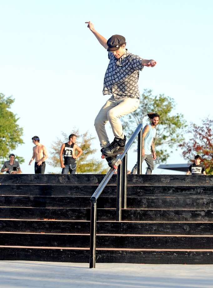 Isaac Parks, 19, traveled down from Humble to rollerblade at the Beautiful Mountain Skate Plaza on Tuesday, August 6, 2013.  While there Parks landed this christ makio grind down the handrail.  Photo taken: Randy Edwards/The Enterprise Photo: Beaumont Enterprise