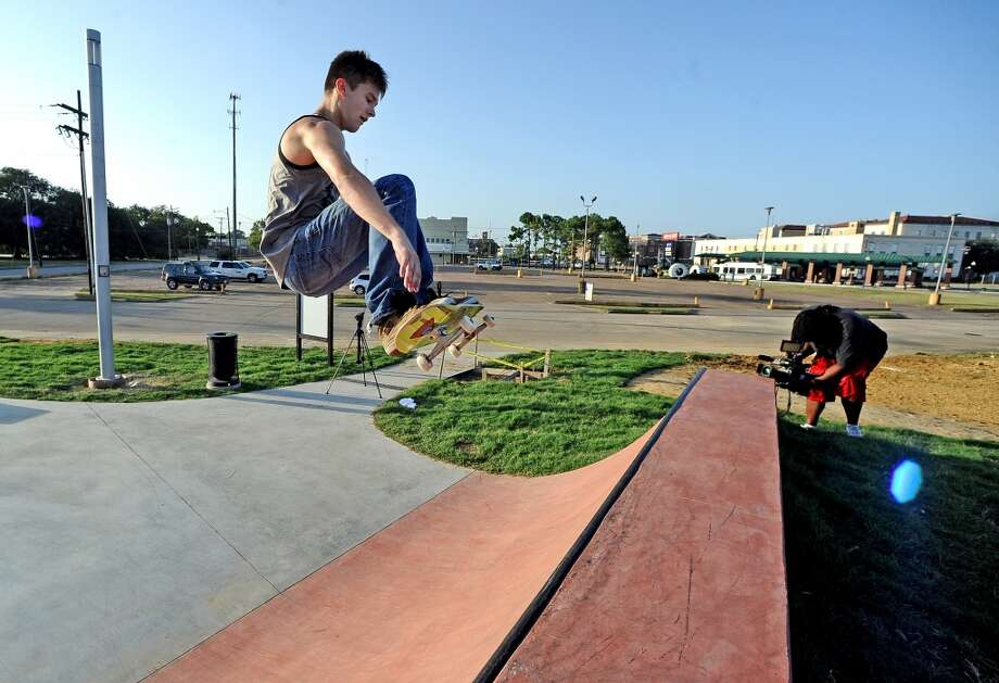 Miles Watson, 19, airs out of the quarter-pipe on his skateboard at the Beautiful Mountain Skate Plaza on Tuesday, August 6, 2013. Photo taken: Randy Edwards/The Enterprise Photo: Beaumont Enterprise