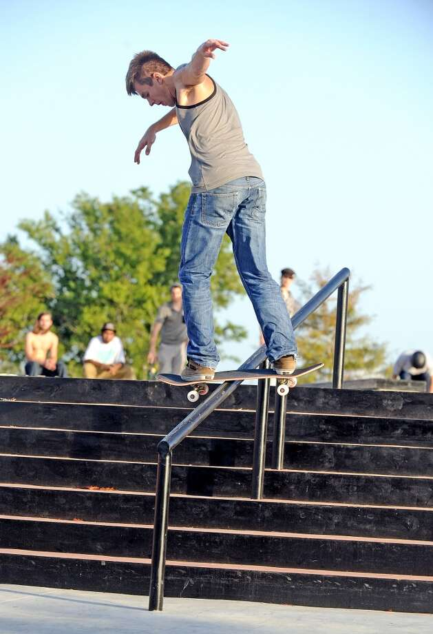 Miles Watson, 19, board-slides the handrail on his skateboard at the Beautiful Mountain Skate Plaza on Tuesday, August 6, 2013. Photo taken: Randy Edwards/The Enterprise Photo: Beaumont Enterprise