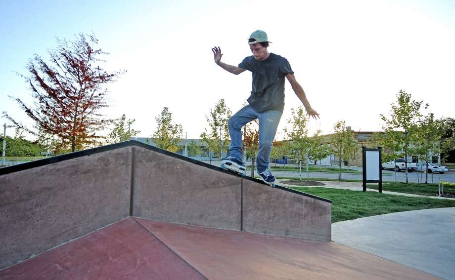 Local comedian Jack Neil laces a tru mizou on the A-frame ledge at the Beautiful Mountain Skate Plaza on Tuesday, August 6, 2013. Photo taken: Randy Edwards/The Enterprise Photo: Beaumont Enterprise
