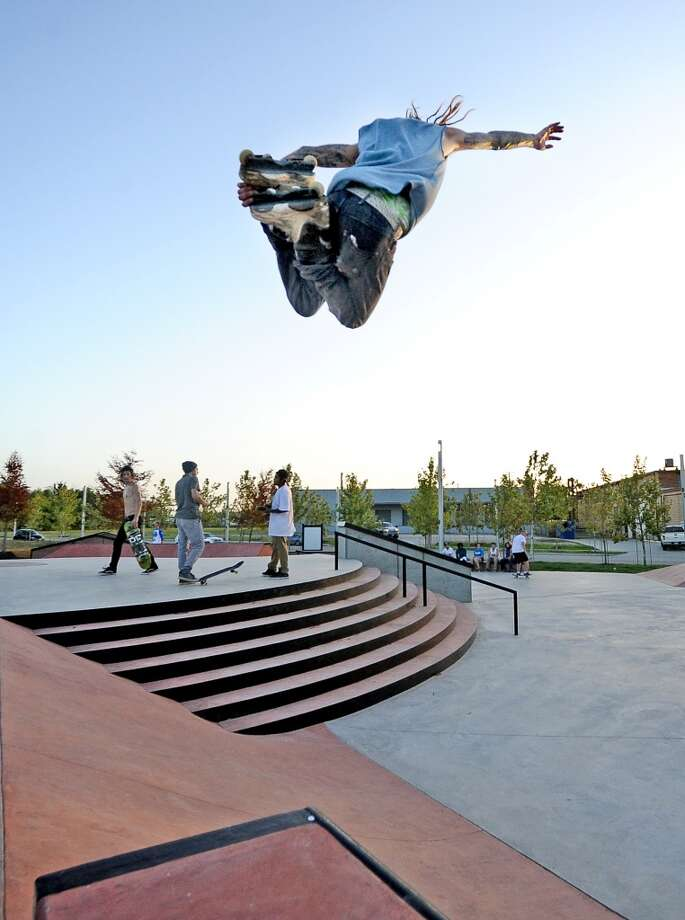 Simon Gonzales hurls himself into the air from the quarter-pipe at the Beautiful Mountain Skate Plaza on Tuesday, August 6, 2013. Photo taken: Randy Edwards/The Enterprise Photo: Beaumont Enterprise