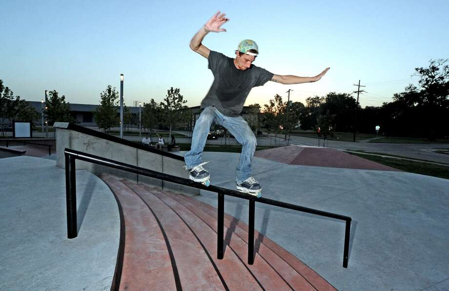 Local comedian Jack Neil does a royale down the handrail at the Beautiful Mountain Skate Plaza on Tuesday, August 6, 2013. Photo taken: Randy Edwards/The Enterprise Photo: Beaumont Enterprise