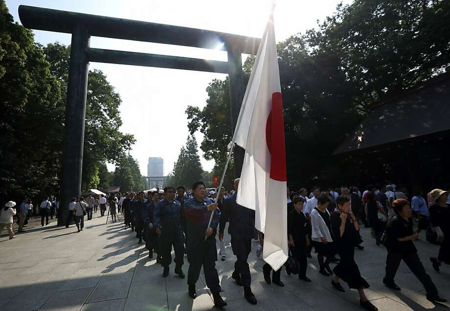 Protesters march at the Yasukuni Shrine on the anniversary of Japan's World War II defeat. Photo: Tomohiro Ohsumi, Bloomberg