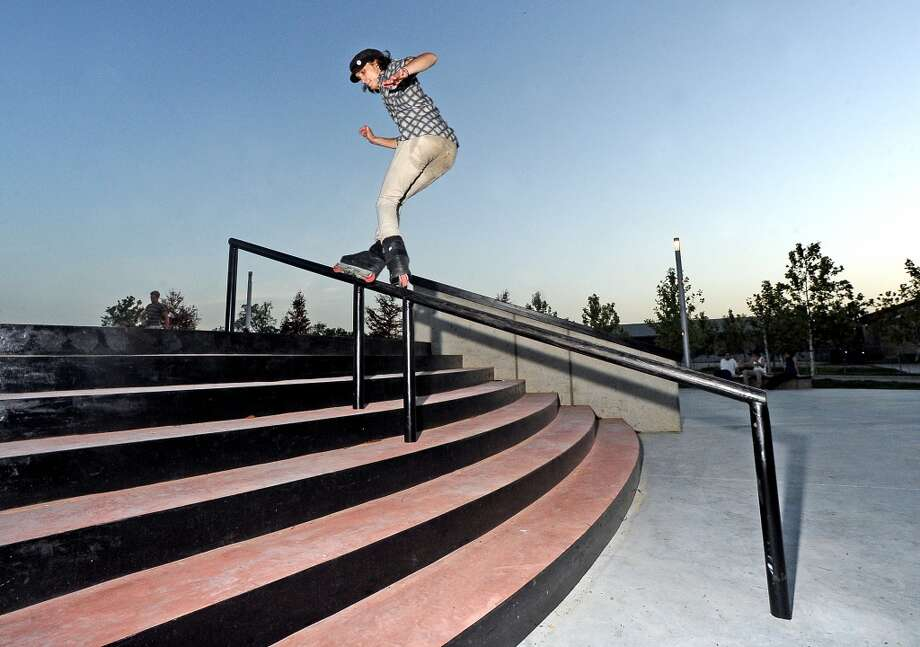 Isaac Parks, 19, does an alley-oop topside pornstar down the handrail at the Beautiful Mountain Skate Plaza on Tuesday, August 6, 2013. Photo taken: Randy Edwards/The Enterprise Photo: Beaumont Enterprise