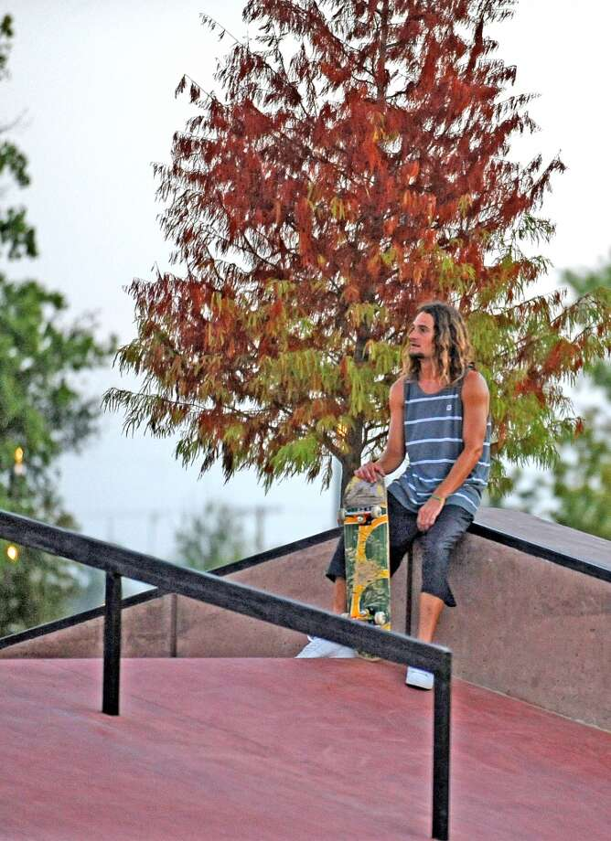 Chris Leger, 29, takes a break on top of the A-frame on opening day at the Beautiful Mountain Skate Plaza on Tuesday, August 6, 2013. Photo taken: Randy Edwards/The Enterprise Photo: Beaumont Enterprise