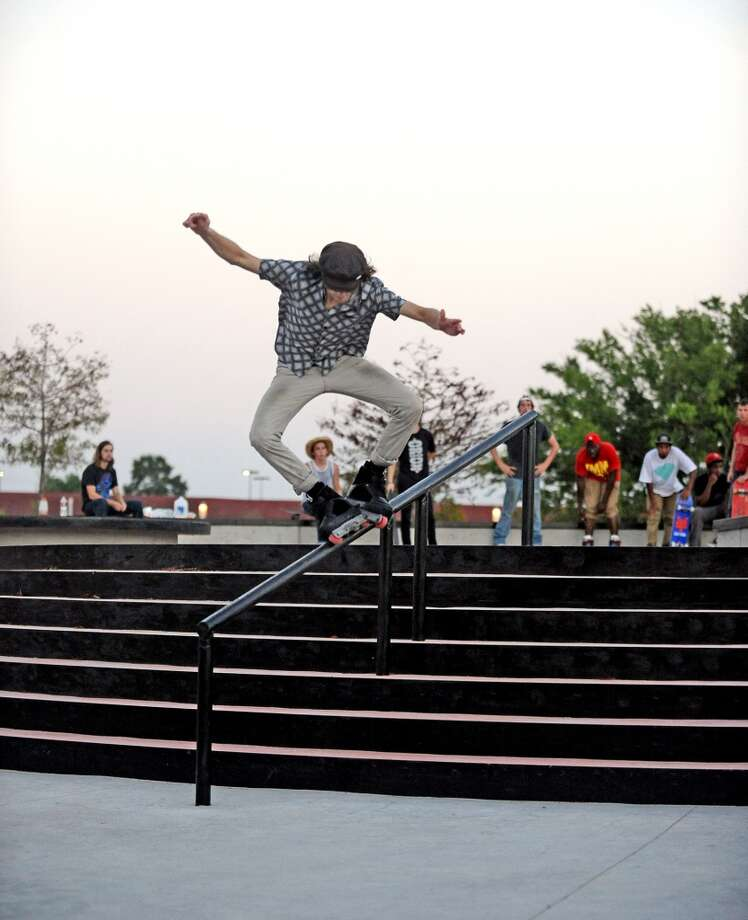 Isaac Parks, 19, topside mistrials down the handrail at the Beautiful Mountain Skate Plaza on Tuesday, August 6, 2013. Photo taken: Randy Edwards/The Enterprise Photo: Beaumont Enterprise