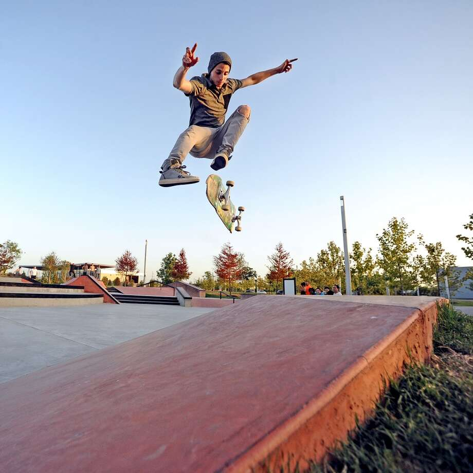 Bryan Seymour, 22, laces a 360 double kickflip on the pyramid at the Beautiful Mountain Skate Plaza on Tuesday, August 6, 2013. Photo taken: Randy Edwards/The Enterprise Photo: Beaumont Enterprise