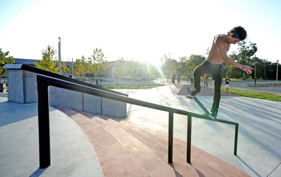 Nathan Hammond, 21, locks a backside nose blunt on his skateboard at the Beautiful Mountain Skate Plaza on Tuesday, August 6, 2013. Photo taken: Randy Edwards/The Enterprise Photo: Beaumont Enterprise