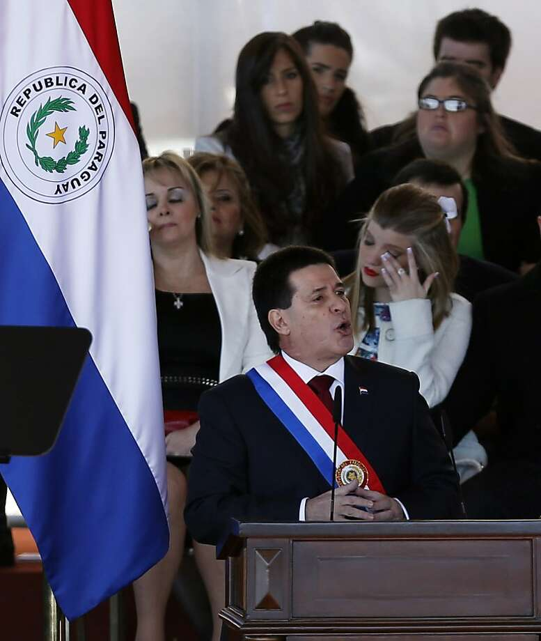 Paraguay's new President Horacio Cartes delivers his speech during his swearing-in ceremony at Palacio de Lopez presidential palace in Asuncion, Paraguay, Thursday, Aug. 15, 2013. Cartes, 57, is a multimillionaire who built a family fortune by dominating industries from banking to tobacco to soft drinks to soccer. (AP Photo/Jorge Saenz) Photo: Jorge Saenz, Associated Press