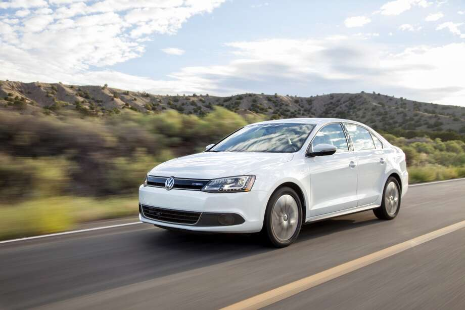 6. Volkswagen Jetta Hybrid  Lifecycle emissions based on 100,000 miles of driving in U.S.: 0.73 pounds of carbon dioxide equivalents per mile  [Photo: The 2013 Jetta Hybrid has the highest mileage rating ever, a combined 45 miles per gallon in city and highway travel.] Photo: Volkswagen, ASSOCIATED PRESS