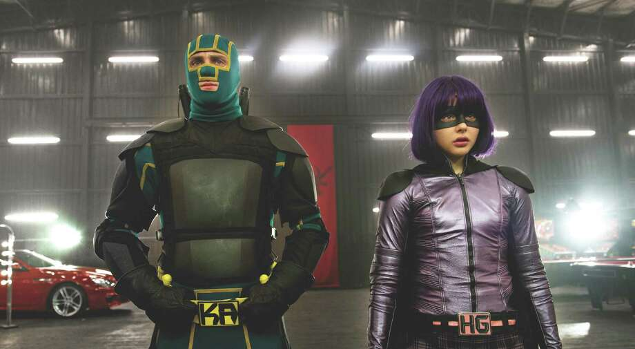 """Photo Credit: Daniel Smith/Universal Studios.  Young masked hero Kick-Ass (AARON TAYLOR-JOHNSON) and the blade-wielding Hit Girl (CHLOE GRACE MORETZ) return for the follow-up to 2010's irreverent global hit: """"Kick-Ass 2"""". Photo: Daniel Smith / © Universal Pictures"""