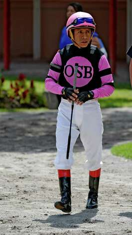 Jockey Edgar Prado prepares for a mount Wednesday, July 31, 2013, at Saratoga Race Course in Saratoga Spings, N.Y. (Skip Dickstein/Times Union) Photo: SKIP DICKSTEIN / 10023354A