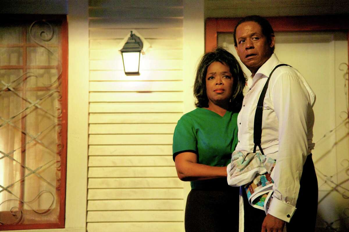 This film image released by The Weinstein Company shows Oprah Winfrey as Gloria Gaines, left, and Forest Whitaker as Cecil Gaines in a scene from