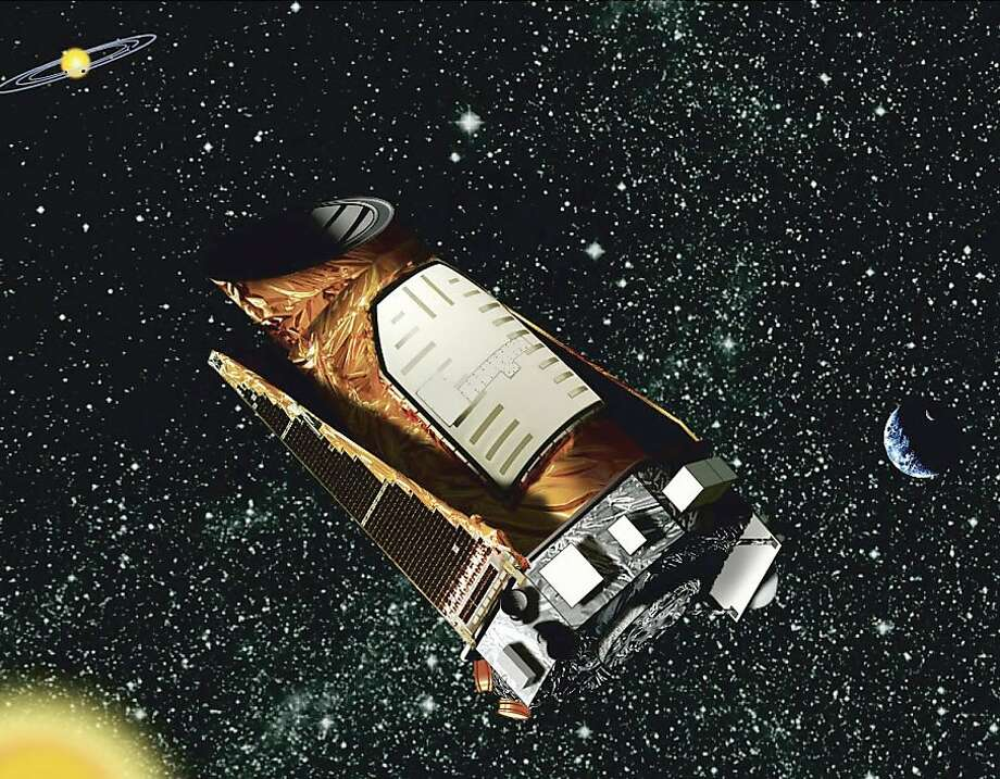 An artist's rendering shows the Kepler space telescope, launched in 2009, which has confirmed 135 exoplanets - planets outside our solar system. Photo: Uncredited, Associated Press