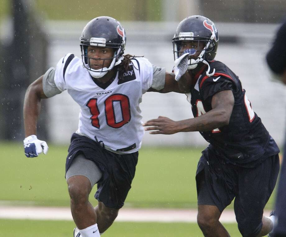 Wide receiver DeAndre Hopkins (10) battles against cornerback Johnathan Joseph (24) in a drill. Photo: Karen Warren, Chronicle