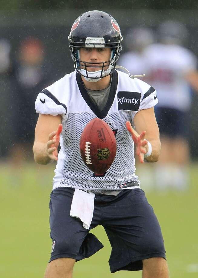 Quarterback Case Keenum takes a snap. Photo: Karen Warren, Chronicle