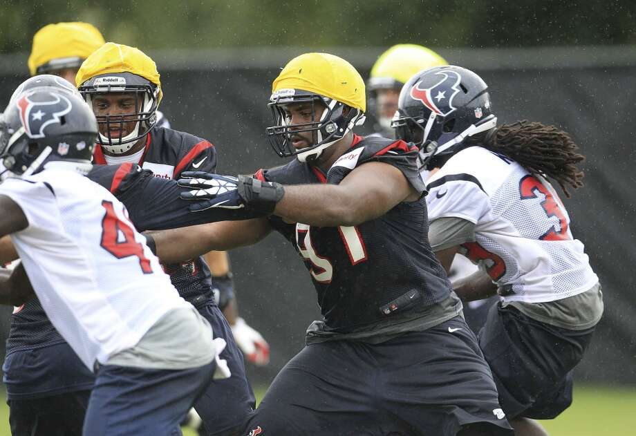 Defensive tackle Terrell McClain (center) takes part in a drill. Photo: Karen Warren, Chronicle