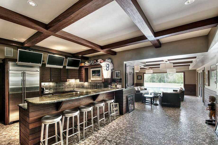 This suburban estate features six bedrooms and five bathrooms in more than 12,000 square feet of living space. The asking price is $4.75 million.See the listing here.