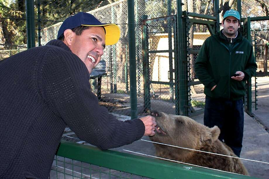 No refunds for devoured customers:Tourist Manu Pelcat feeds Gordo, a 3-year-old 