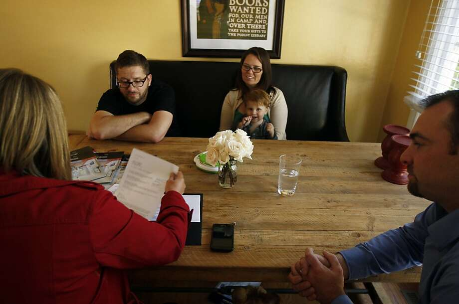 Josh and Jessica Rowe, with son Harrison (rear), meet at their rented home in San Carlos with real estate agents Tanja Beck and Scott Rose about the sale of their condominium in San Francisco's Haight-Ashbury neighborhood. Photo: Rohan Smith, The Chronicle