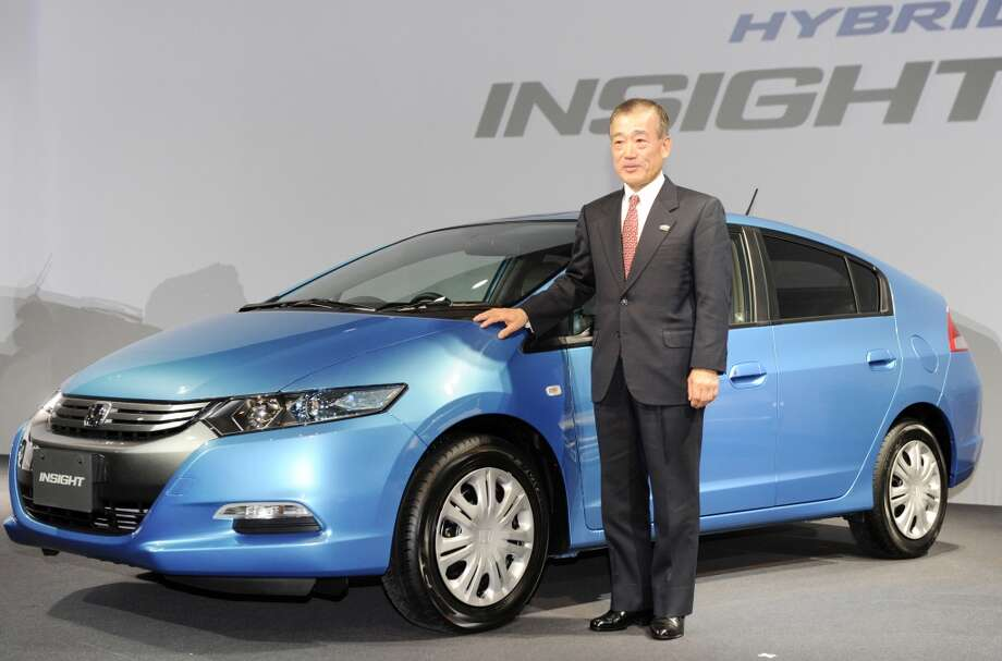 "5. Honda Insight Hybrid  Lifecycle emissions based on 100,000 miles of driving in U.S.: 0.72 pounds of carbon dioxide equivalents per mile  [Photo: Honda Motor president Takeo Fukui introduces the new hybrid five-door hatchback vehicle ""Insight"", equipped with a 1.3-litre gasoline engine and an electric motor hybrid system, at a Tokyo hotel on February 5, 2009.] Photo: YOSHIKAZU TSUNO, AFP/Getty Images"