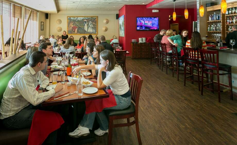 People enjoy dinner at Vanessa's Bistro 2 in Walnut Creek. Photo: John Storey, Special To The Chronicle