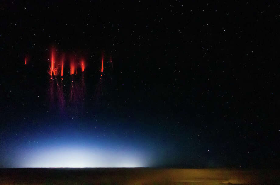 This is an upper atmosphere electrical discharge called a sprite. The photo was taken over the U.S. by scientist Jason Ahrns recently while aboard the National Center for Atmospheric Research's Gulfstream V research aircraft. (Photo: Jason Ahrns/Flickr) Photo: Multiple