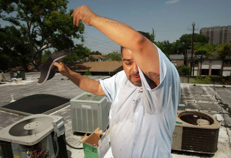 """This time of year, people want their houses cold, but it's just so hot, the units can't handle it,"" Stuffy Martinez says. The 46-year-old took over the family business from his father in February.        ""This time of year, people want their houses cold, but it's just so hot, the units can't handle it,"" Stuffy Martinez says. The 46-year-old took over the family business from his father in February. Photo: Johnny Hanson, Staff / © 2013  Houston Chronicle"