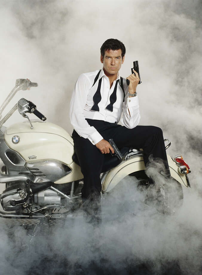 Pierce Brosnanposes as James Bond on a BMW. Photo: Keith Hamshere, Getty Images / 2011 Keith Hamshere