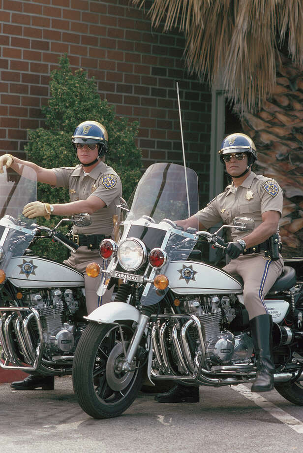 "Larry Wilcoxas Officer Jon Baker and Erik Estrada as Officer Francis Llewellyn 'Ponch' Poncherello in ""CHiPs."" Photo: NBC, NBC Via Getty Images / 2012 NBCUniversal, Inc."