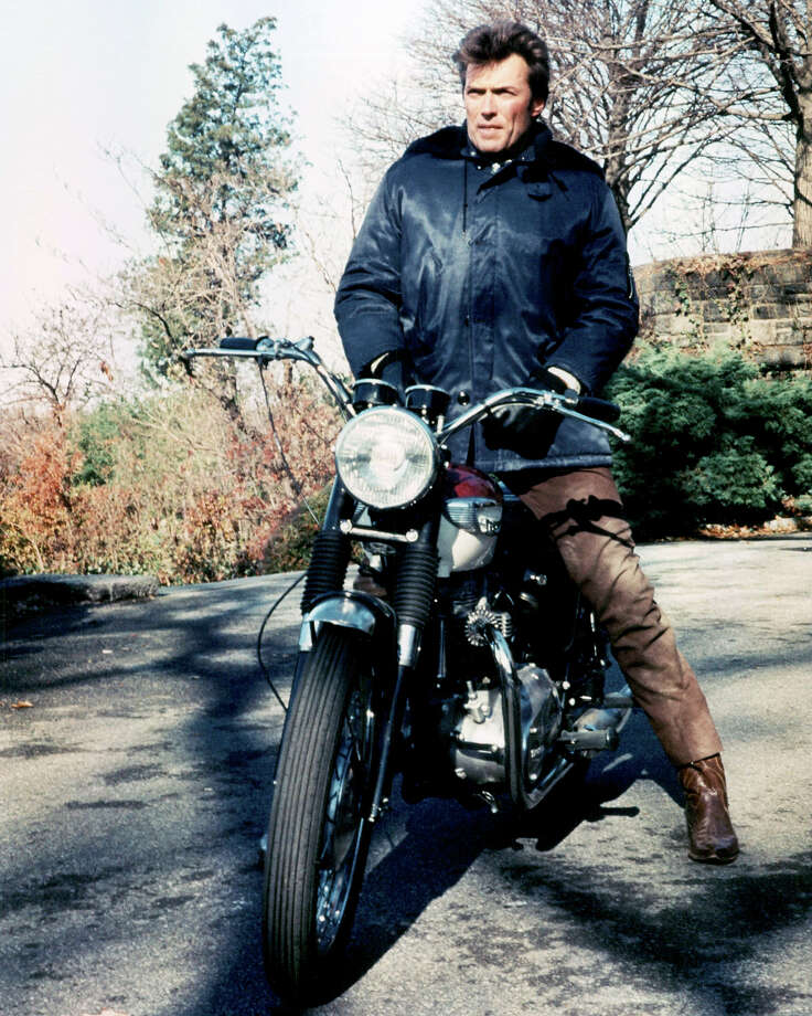 Clint Eastwoodposes on a Bonneville. Photo: Silver Screen Collection, Getty Images / Moviepix