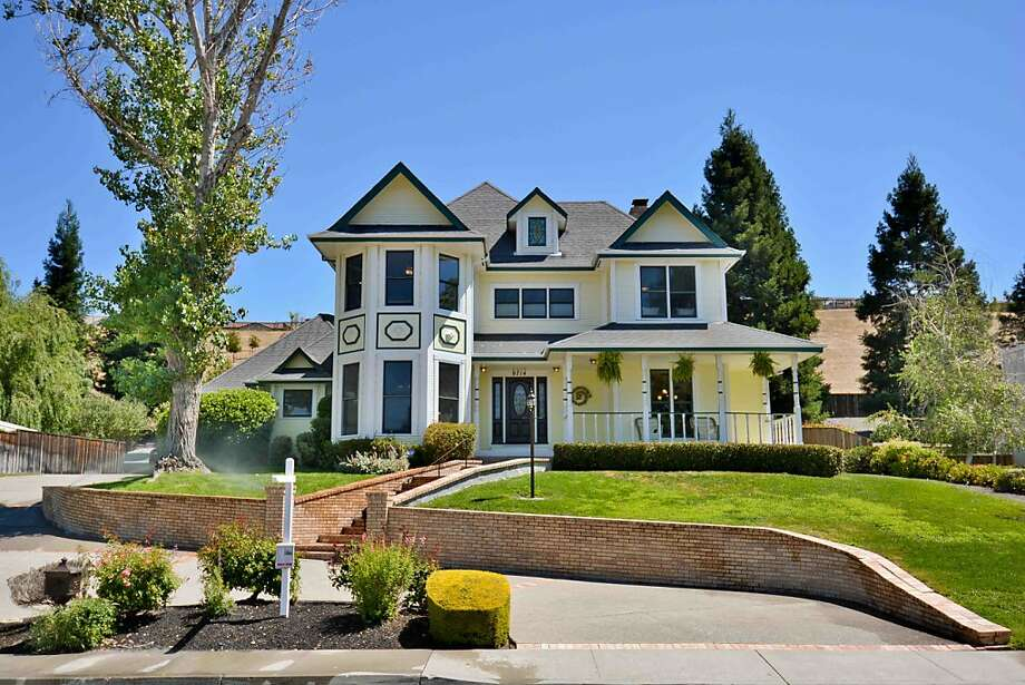 91714 Alcosta Blvd. is a four-bedroom Victorian home in San Ramon available for $1.1 million. Photo: AllAccessPhoto.com