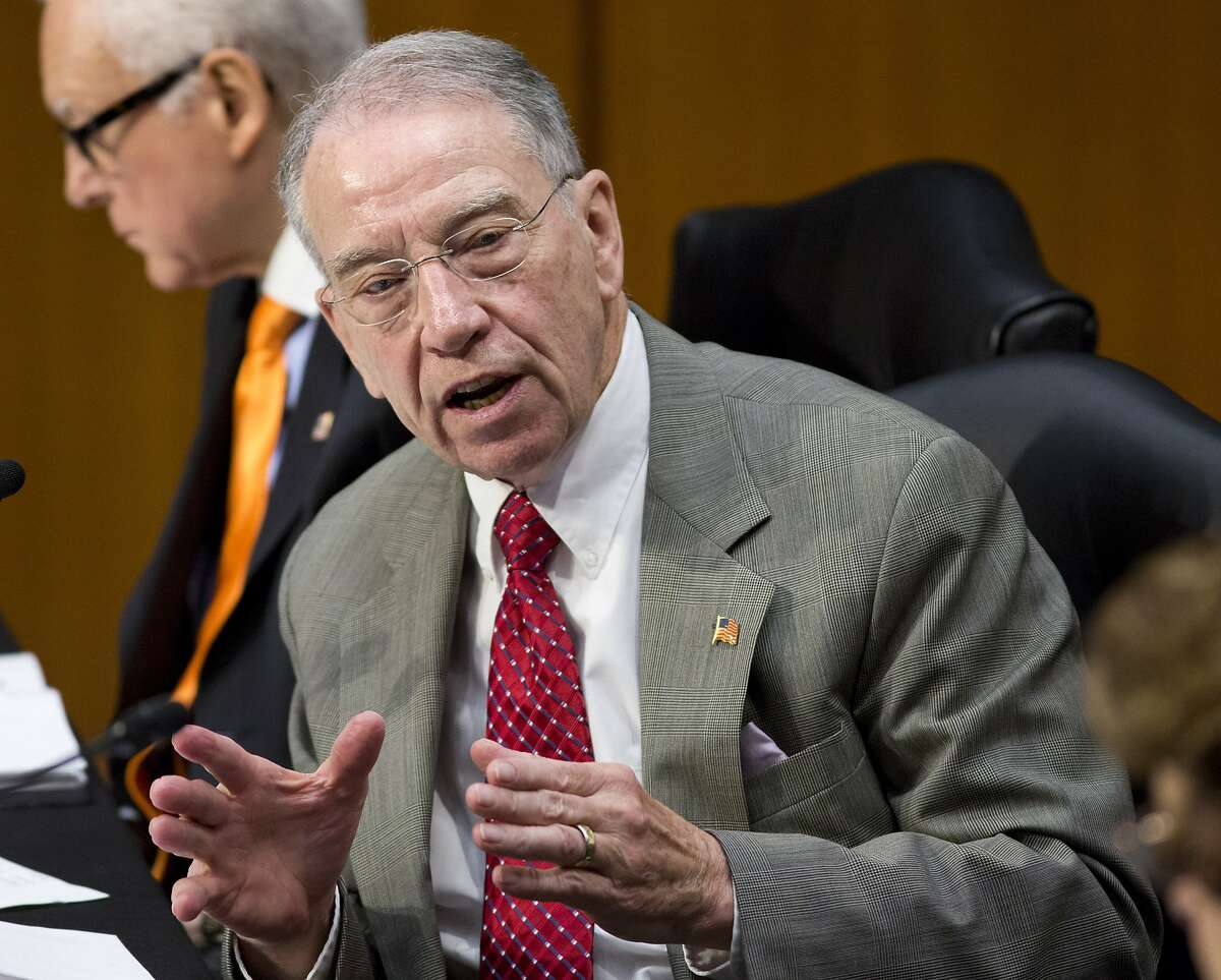 FILE - In his May 9, 2013 file photo, Sen. Charles Grassley, R-Iowa speaks on Capitol Hill in Washington. The Obama administration has tossed back in the lap of Congress a prickly political question involving health insurance for staffers and lawmakers themselves. Proposed regulations issued Wednesday say lawmakers' offices should individually decide whether staffers are subject to a health law provision that would require them to switch their insurance from the federal plan to new coverage coming next year under President Barack Obama's overhaul. The rules do clarify that the government will continue to pay its standard share of premiums, resolving one of the biggest unknowns about the health law provision, which was authored by Grassley. (AP Photo/J. Scott Applewhite, File)