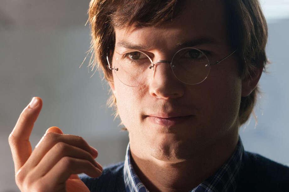 Ashton Kutcher as Steve Jobs with glasses. Photo: Glen Wilson / © Open Road Films
