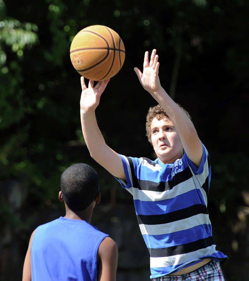 Joey Frangione, 13, of Greenwich, launches a three-point shot during a basketball game of Twenty-one at the Hamilton Avenue School court in Chickahominy, Thursday, August 15, 2013. Photo: Bob Luckey / Greenwich Time