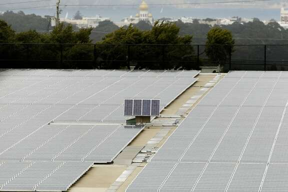 The roof of the Sunset Reservoir, in San Francisco, Calif., on Saturday Sept. 15,2012, is covered with solar panels.  After eight years, San Francisco is on the threshold of taking a major step into the public power realm. The program, CleanPowerSF, is designed to build a customer base and revenue stream to lay the groundwork for city-owned renewable power generation while advancing San Francisco's aggressive greenhouse gas reduction goals.